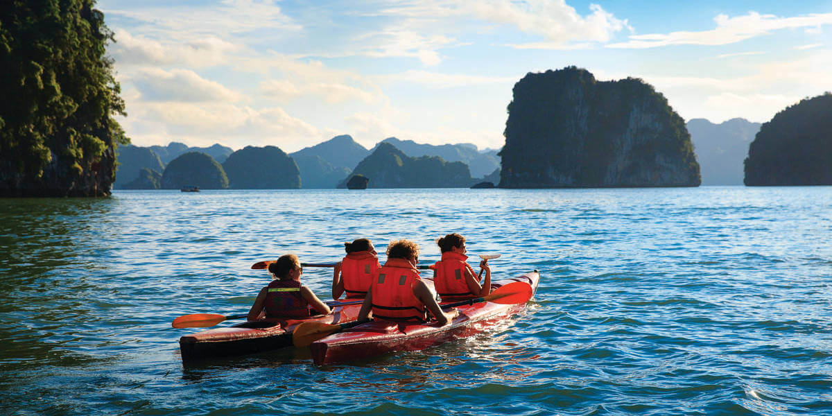view from behind of 2 kayaks side by side in Halong Bay