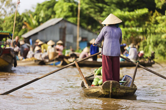 Experience the unique floating markets in Mekong delta tours